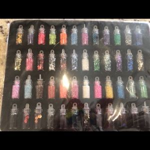 48 bottles of beauty glitters nails, eyes,lips etc